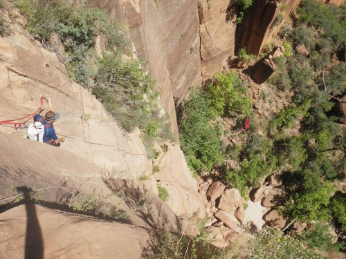 Bombs away!  Brad Barlage gives the rope bag a chuck on the final 150' rap out of Behunin and into the Emerald Pools.