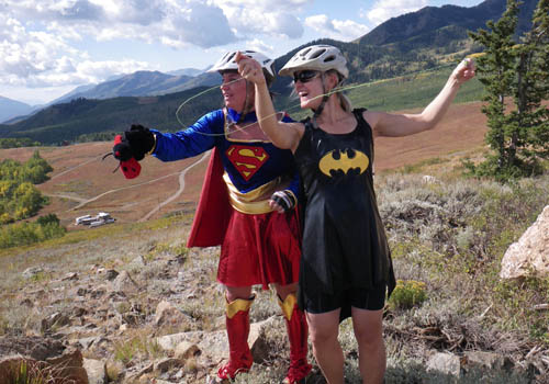 Super Woman and Bat Girl blow off steam at the end of the race by flying the world's tiniest kites.  These things were about the size of my palm and were flown on cotton sewing thread.  Very cool and colorful.