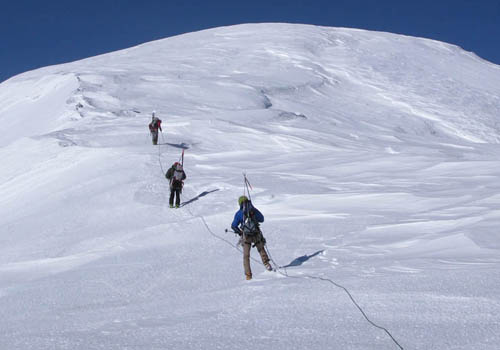 Nearing the summit of Sultana as a four-person team on a 60m rope.