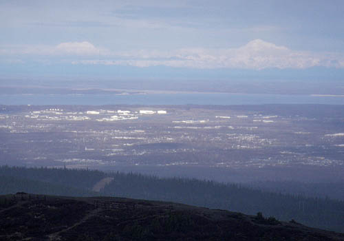 Sultana on the left and Denali on the right with Anchorage in the foreground.