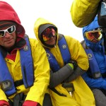 Mark Sedon, Chris Davenport and Doug Stoup batten down the hatches on a cold Zodiac ride.