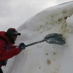 Andrew Eisenstark digging out a hut.
