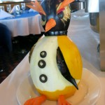 A melon penguin in the main dining room.