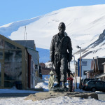 Downtown Longyearbyen with a statue memorializing the town's mining heritage.  The town is named after an American, John Longyear, who owned the Arctic Coal Company.