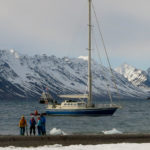 On the beach with Arctica II in the background.