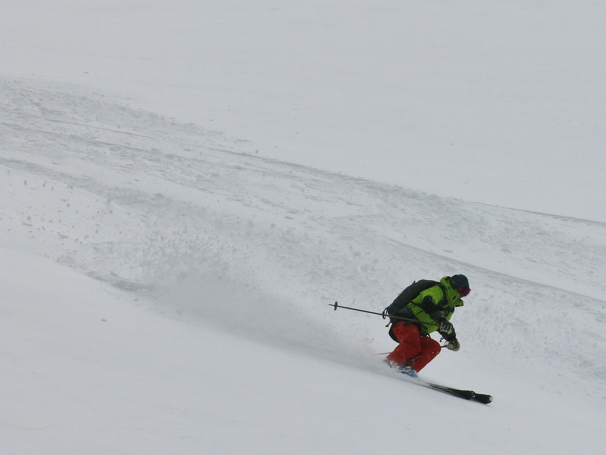 Yves in his element – skiing powder.